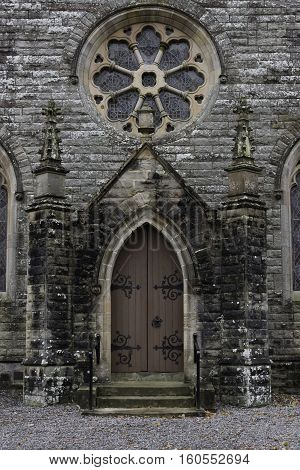 An old church doorway  with a stained glass circular window