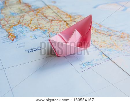 Shipping and boat travel concept Pink paper boat(Origami boat) on map of sea thailand with copy space