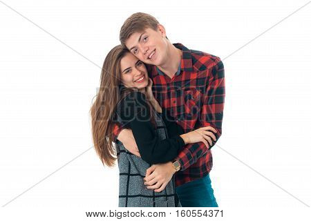 portrait of young sensual stylish couple in love having fun in studio isolated on white background