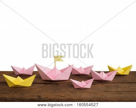 Shipping and travel concept Many paper boat(origami boat) on wooden table of white background