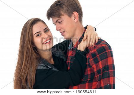portrait of young lovely stylish couple in love having fun in studio isolated on white background