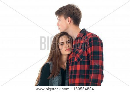 close up of young lovely stylish couple in love having fun in studio isolated on white background