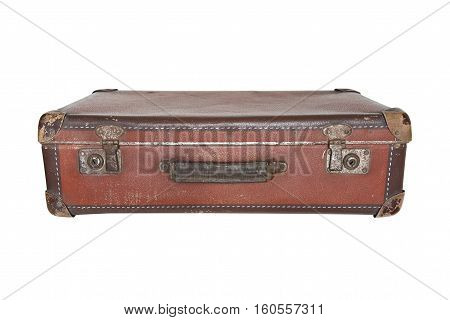 Old worn warped travel suitcase on white background
