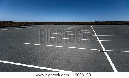 Empty Space in a Parking Lot with blue sky