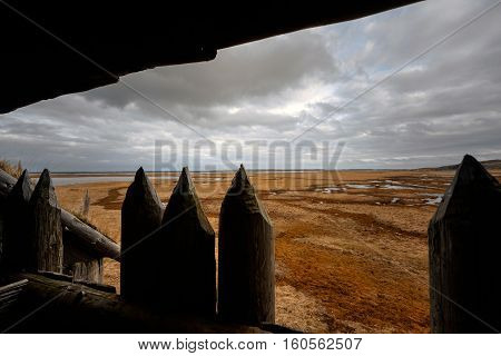 View from barricade with sharp wooden fence