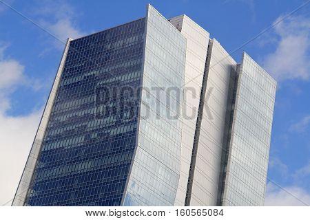 a modern building on a blue sky