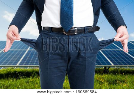 Businessman Showing Empty Pockets In Solar Power Station