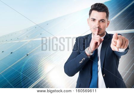 Portrait Of Young Business Man Doing Shush Gesture