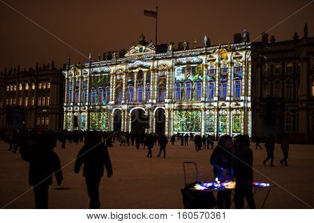 Saint-Petersburg Russia - December 7 2016: light show at the Palace Square in the city to celebrate the anniversary of the State Hermitage Museum. Light effects on the walls of the buildings of the State Hermitage.