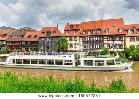 BAMBERG, GERMANY - JUNE 2, 2016:  Sightseeing boat trip on Regnitz river in Bamberg, Upper Franconia, Germany