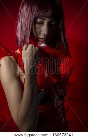 Anime, Oriental girl with red plastic costume, futuristic cosplay costumes