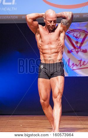 MAASTRICHT THE NETHERLANDS - OCTOBER 25 2015: Male bodybuilder Erik Stobbe shows his best front pose at the World Grandprix Bodybuilding and Fitness of the WBBF-WFF