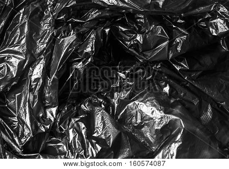 texture of crumpled cellophane black abstract polygon, geometric,