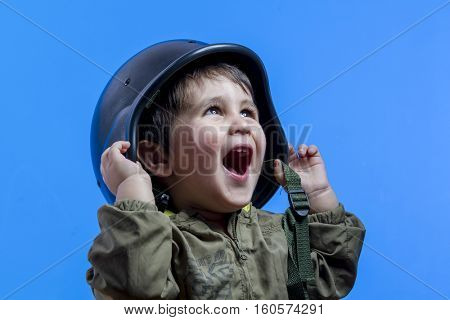 success, fun and funny child dressed in militar hat and goggles