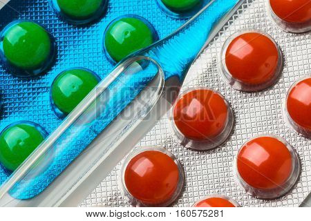 Ampule With Medicines On The Background Of Tablets