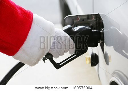 Santa Claus Gas Station Fill up. Santa refuels his truck before Christmas eve.