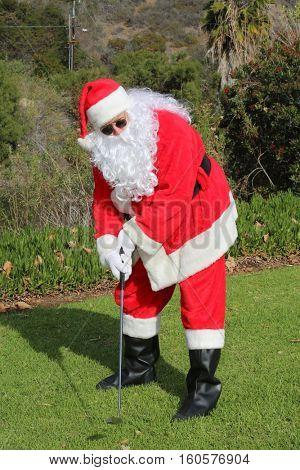Christmas Santa Claus plays golf. Santa Golf.