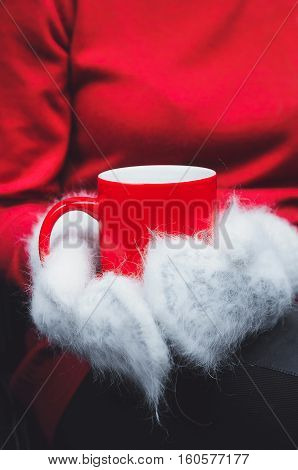 Girl In Red Sweater And White Mittens Holding Hot Cup