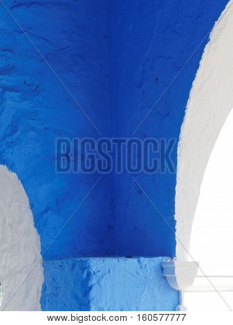 Blue archway abstract at Portmeirion Gwynedd Wales. The archway is part of the Casino near the hotel