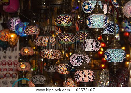 Turkish lanterns / Turkish lanterns mosaic, flashlights on the market, oriental flavor. Display of turkish lanterns on sale at the Grand Bazaar.