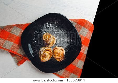 Delicious And Beautiful Apple Rose Puff Pastries Lies On Table