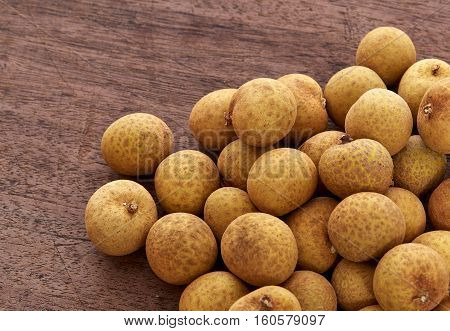 Fresh longan on a wooden backgroundTropical fruits of Thailand.