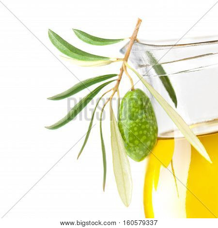 Green Olive and Glass Bottle of Organic Olive Oil Isolated on White Background
