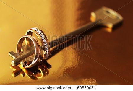 Wedding rings and key, happy and love
