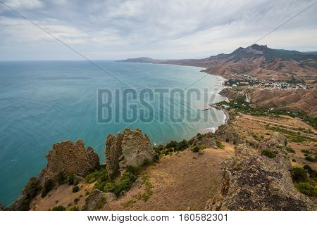 Picturesque resort town near sea shore, rocks and skyline at summer day