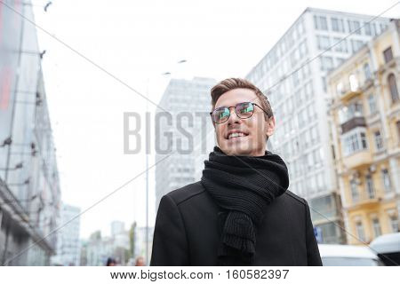 From below portrait of business man in glasses on the street