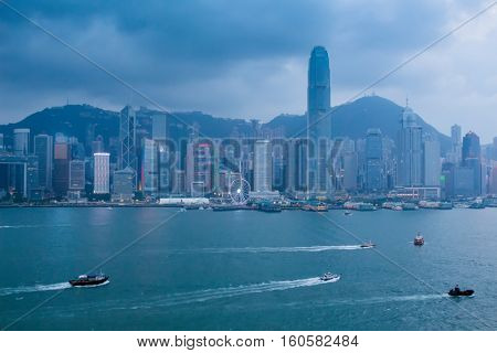 Shore and skyscrapers in fog on waterside in Hong Kong, China, view from Starhouse