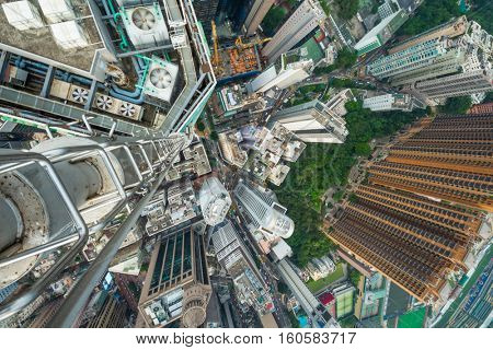 High skyscrapers, office buildings roofs in Hong Kong city, China, aerial view from Manulife Plaza