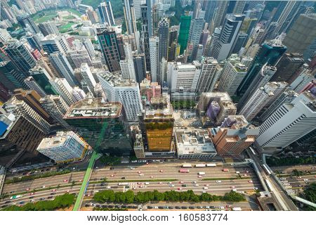 Skyscrapers, buildings, highway in Hong Kong city, China at sunny day, top view from China Resources Building