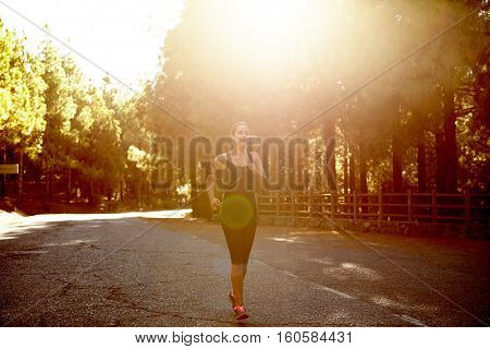 Healthy Young Brunette Woman Jogging Alone