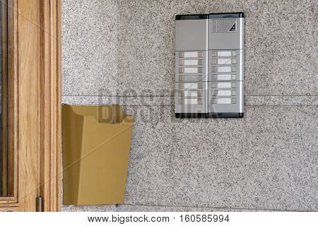 image of intercom near a wooden door