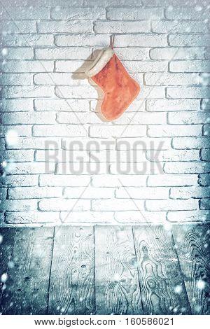 Christmas Stocking On Brick Wall