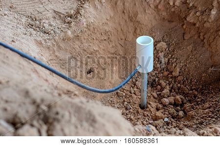 Welding copper ground wire on ground rod.