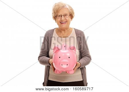 Happy elderly woman with a piggybank isolated on white background