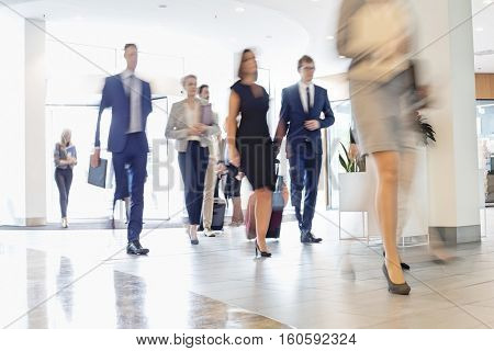 Blurred motion of business people walking at convention center