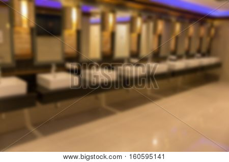 Blurred Background Of Faucet And Sink In Public Restroom Toilet