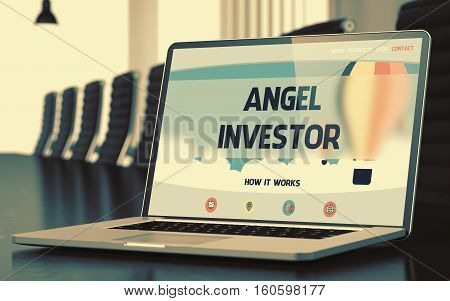 Mobile Computer Display with Angel Investor Concept on Landing Page. Closeup View. Modern Meeting Room Background. Toned Image. Selective Focus. 3D Illustration.