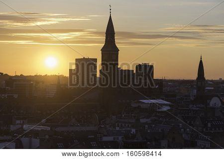 Skyline silhouette of Copenhagen at sunset in Denmark