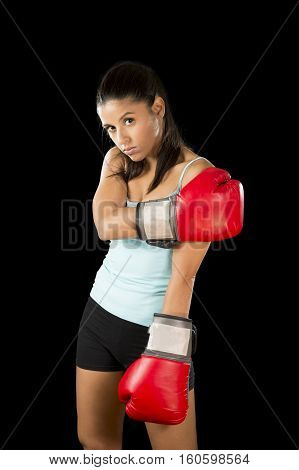 young attractive latin fitness woman with girl red boxing gloves posing in defiant and competitive fight attitude in female boxer and fighter concept isolated on black background