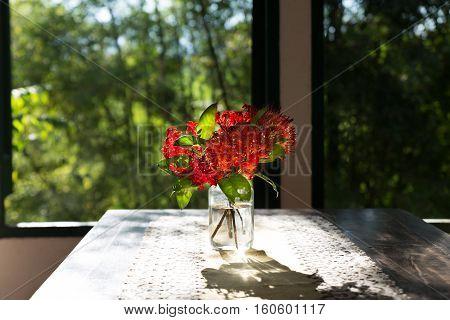 Ixora Flower In Vase On Wood Table Near Window