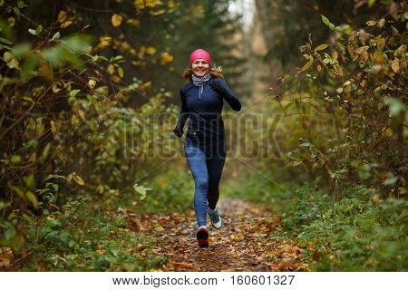 Portrait in full growth of running young women in forest