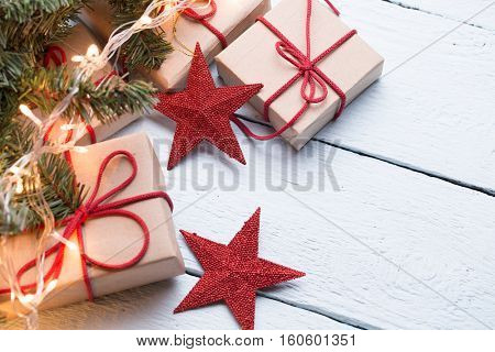 Presents, red stars, fir branch