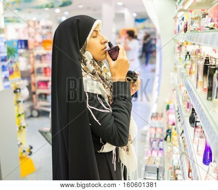 Hijab Arab Muslim lady doing shopping in big modern city mall
