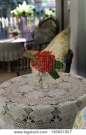 Ixora Flower, Knitted Tablecloth On Table, Pillow On Rattan Chair In Living Room