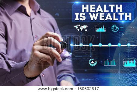 Technology, Internet, Business And Marketing. Young Business Person Sees The Word: Health Is Wealth