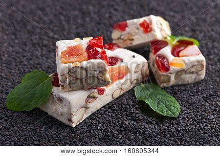 Soft Nougat With Tropical Fruit And Berries On Black Sesame